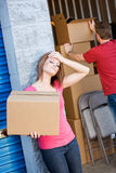 Storage: Tired of Working in Storage Unit Royalty Free Stock Photo