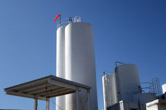 Storage towers at dairy plant Stock Photo