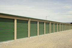 Storage Units. Green and beige outdoor self storage units Stock Photography