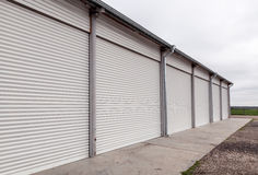 Storage units with roller shutter doors in industrial area Royalty Free Stock Photography