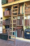 Storage of vintage suitcases. Different sizes and colors Royalty Free Stock Photo