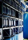 Storage warehouse. Blue containers in an industrial storage warehouse Stock Photography
