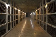 The storage of wine bottles in a wine cellar. Stock Photo