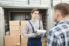 Storage worker talking to container owner royalty free stock photo