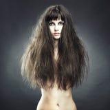storartad kvinna för härligt hår royaltyfri fotografi