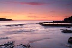 Storartad soluppgång på Malabar Australien royaltyfria bilder