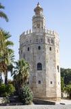 Storartat torn av guld i Seville Royaltyfri Foto