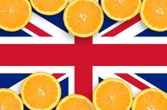 Storbritannien flagga i citrusfruktskivahorisontalram arkivbild