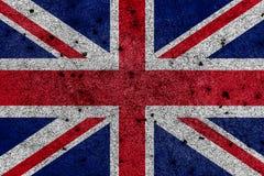 Storbritannien flagga som är bekant som Union Jack som målas på grungeväggen royaltyfri illustrationer