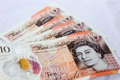 Storbritannien pund på vit bakgrund arkivbild