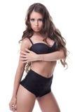 Storbystad barnmodell som poserar i stilfull damunderkläder Arkivbild