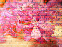 Storczykowy kwiat na Czerwonej ściana z cegieł teksturze zdjęcia royalty free