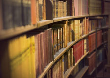 Store with antique books. Libray or book store with rows of old antique books Royalty Free Stock Photos