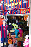 Store of apparel and souvenirs with FC Barcelona symbolics. BARCELONA, SPAIN - APRIL 5, 2015: Ordinary store of apparel and souvenirs with FC Barcelona symbolics Stock Photo