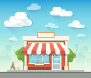 Store building in front of cloudy sky Stock Photography