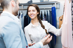 Store clerk serving purchaser Royalty Free Stock Photography