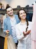 Store clerk serving purchaser Royalty Free Stock Image
