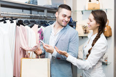 Store clerk serving purchaser Stock Photo