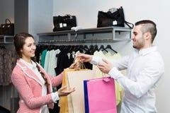 Store clerk serving purchaser Stock Image