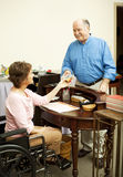 Store Clerk in Wheelchair Royalty Free Stock Photography
