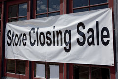 Store Closing. Sign on small retail store Stock Image