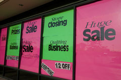 Store closing. Bright store closing signs in a suburban shopping center royalty free stock image