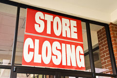 Store Closing Banner Revised. A Store Closing sign over the door of a store going out of business Royalty Free Stock Photos