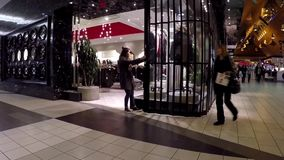 Store closing down at night inside Coquitlam center mall. stock video footage