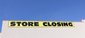Store Closing Sign. A retail store going out of business sign Royalty Free Stock Photo