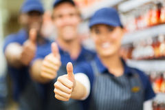 Store co-workers thumbs up Royalty Free Stock Photo