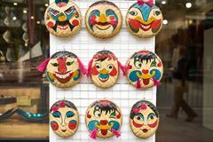 Store with colorful emotional face bamboo masks in Hanoi royalty free stock photo