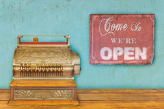 Store concept with cash register and open sign Stock Photos