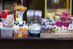 Store counter with sweets: gingerbread, gums and lollipop. Lviv, Ukraine - January 22, 2017: Store counter with sweets: gingerbread in basket, gums and lollipops Royalty Free Stock Photography