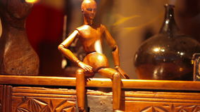 Small mannequin of antique wood decoration. Store decoration items at Paris. Antique decoration from an antiquarian with a small old wooden mannequin stock video footage