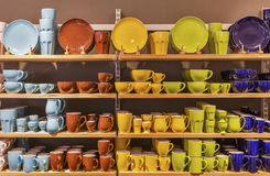 Store display of colorful tableware on the shelves. Royalty Free Stock Photo
