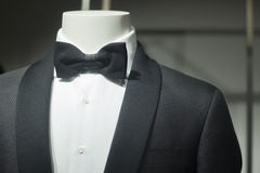 Store dummy in dinner jacket and bow tie. Shop dummy fashion mannequin in department store boutique window wearing evening suit dinner jacket and bow tie Royalty Free Stock Photography