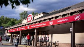 Store front of IGA store. IGA are a network of small independent supermarkets in Canada
