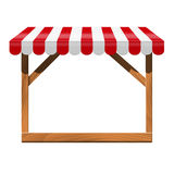 Store front with red awning and wooden rack. Stock Photos