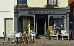 Store front of The Shop at Forty which sells Retro and Vintage wares with chairs and tables outside on the pavement. Stock Photos