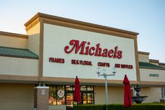 A store front sign for Michaels stock images