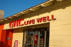 A store sign for GNC royalty free stock photo