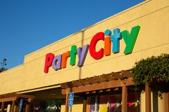 The store front sign for Party City stock photography