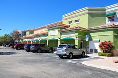 Store front strip mall, South Florida. Parking lot and storefront in strip center shopping plaza Royalty Free Stock Photography