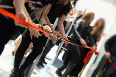 Store grand opening - cutting red ribbon. New store grand opening - cutting red ribbon Royalty Free Stock Image