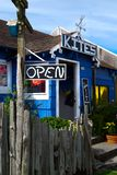 Store with Hand Painted Open Sign. Bright colorful kite shop in Cannon Beach, Oregon with hand painted signage. The kites sold are as colorful as the store royalty free stock photos