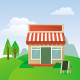 Store house with striped awning Royalty Free Stock Image