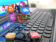 Store of laptop software. Apps icons in shopping cart. Stock Photo