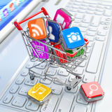 Store of laptop software. Apps icons in shopping cart. Stock Photography