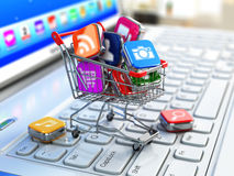 Store of laptop software. Apps icons in shopping cart. Royalty Free Stock Photos