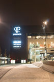 Store logos. POZNAN, POLAND - FEBRUARY 12, 2017: Row of store logos on the Posnania shopping mall by night Stock Photo